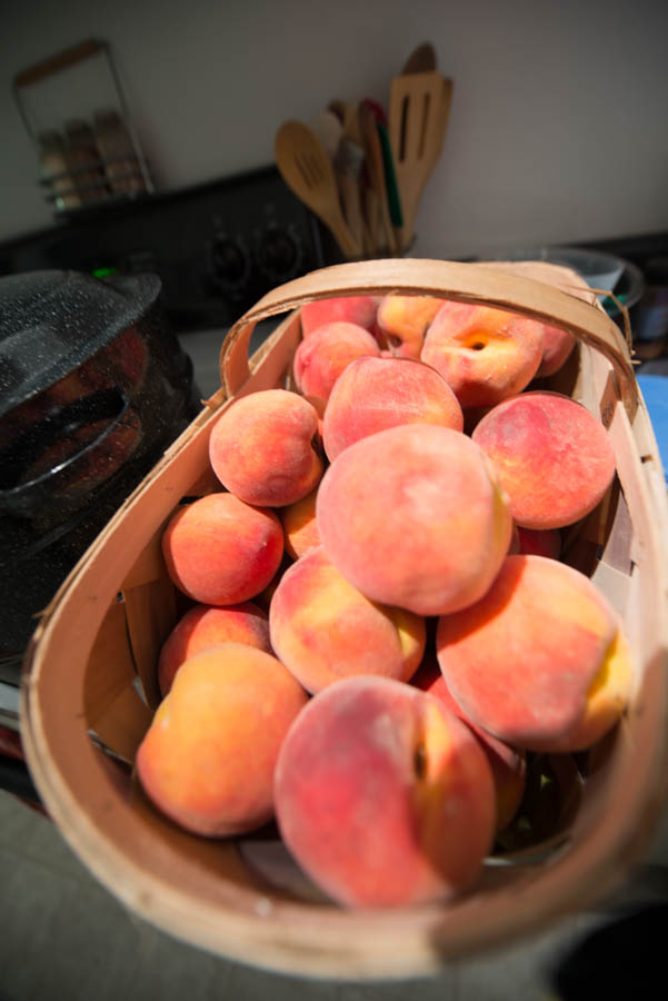 Half bushel of peaches.