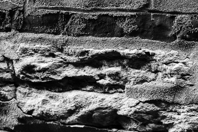 Black and white photo of old granite foundation.