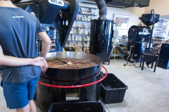 The beans have just left the roaster and are being cooled.