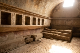 This is inside the women's bath house. The holes in the walls are thought to provide a storage place for women's clothes when they came for a visit.