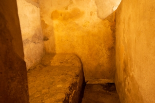 This was one of the beds in the brothel. It's made of stone. They didn't wnat their customers getting too comfortable.